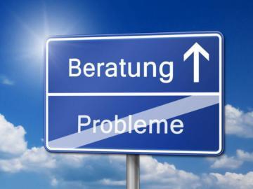 """Gezeigt wird ein blaues Schild auf dem oben """"Beratung"""" und darunter durchgestrichen das Wort """"Probleme"""" steht."""